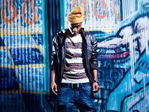 Black youth in front of graffiti wall. Stock Images
