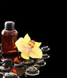 Black Zen stones and essential oil bottle Stock Image