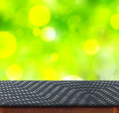 Black zig zag Fabric cover on table with green bokeh background, Stock Photos