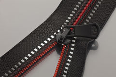 Black zipper with red line Royalty Free Stock Photos