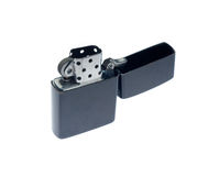 Black zippo lighter. Opened,isolated over white background Royalty Free Stock Images