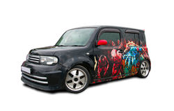 Black Zombie Auto. Japanese car Nissan Cube in the form of a zombie-car isolated on white background Stock Photography