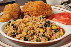 Blackbean quinoa salad with fried chicken Stock Photos