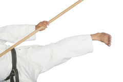 Blackbelt Karate giving a kick with the bo Stock Photos