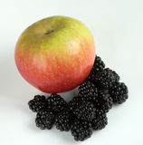 Blackberries and Apple. On a white background royalty free stock images