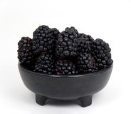 Blackberries in Black Bowl Stock Image