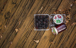 Blackberries with Blackberry jam in bottles. Royalty Free Stock Photography