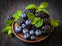 Blackberries, blueberries, mint royalty free stock photos