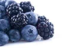 Blackberries and blueberries in a pile Royalty Free Stock Photos