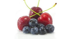 Blackberries and Cherries. Fresh, Wet Blackberries and Cherries isolated on a white background Royalty Free Stock Photos