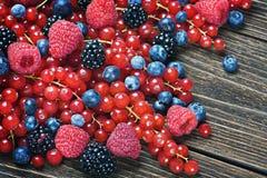 Blackberries, currants, raspberries, blueberries on a wooden tab Stock Photo
