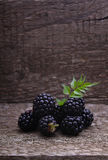 Blackberries. On the old wooden background royalty free stock image