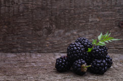 Blackberries. On the old wooden background stock image