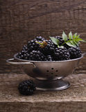 Blackberries. On the old wooden background stock photography
