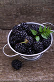Blackberries. On the old wooden background royalty free stock photo