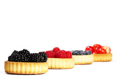 Blackberries and other wild berries in tartlet cak Stock Photography