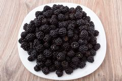 Blackberries on plate Royalty Free Stock Photography