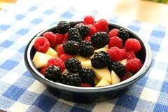 Blackberries, raspberries, and apple in a bowl Royalty Free Stock Photos