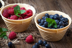 Blackberries, raspberries and blueberries in a waffle bowls. Stock Images