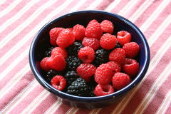 Blackberries and raspberries in a bowl Royalty Free Stock Photography