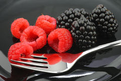 Blackberries, raspberries and a fork Stock Images