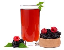 Blackberries with raspberries and juice in glass isolated on white background Stock Images