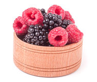 Blackberries and raspberries in a wooden bowl isolated on white background.  Stock Photos