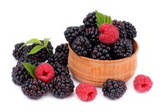 Blackberries with raspberries in wooden bowl isolated on white background Royalty Free Stock Image