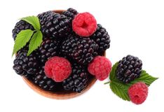 Blackberries with raspberries in wooden bowl isolated on white background top view Stock Photography