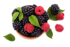 Blackberries with raspberries in wooden bowl isolated on white background top view Stock Photos