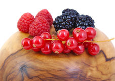 Blackberries, red currants and raspberries on a Royalty Free Stock Images