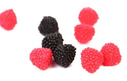 Blackberries and redberry candy. Stock Photos