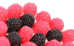 Blackberries and redberry candy Stock Photos