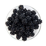 Blackberries on a saucer Stock Photos