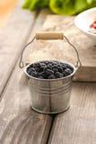 Blackberries in silver bucket Stock Images