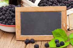 Blackberries and a slate blackboard Stock Photo