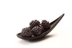 Blackberries on a spoon Stock Photos