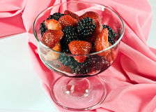 Blackberries and strawberries in bowl Stock Image