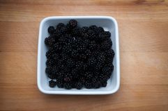 Blackberries in white bowl. Stock Photo