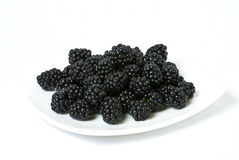Blackberries on a white plate Royalty Free Stock Photography