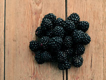 Blackberries on wooden background Stock Photo