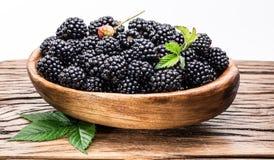 Blackberries in the wooden bowl. Stock Photos