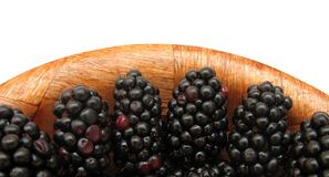 Blackberries in wooden dish Stock Images
