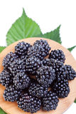 Blackberries on wooden plate Stock Photo