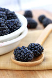Blackberries on Wooden Spoon Stock Photo