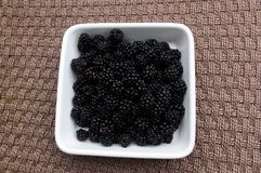 Blackberries on woven  background. Royalty Free Stock Photos