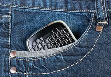 Blackberry. A phone in jeans pocket remove all logos, characters, non-standard button names royalty free stock image