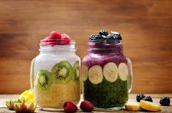 Blackberry banana spinach and raspberry greek yogurt mango banana smoothies in jars. Toning. selective focus royalty free stock image