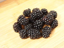 BlackBerry. Blackberries on a wooden surface Stock Photo