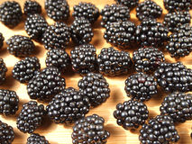 BlackBerry. Blackberries on a wooden surface Royalty Free Stock Images